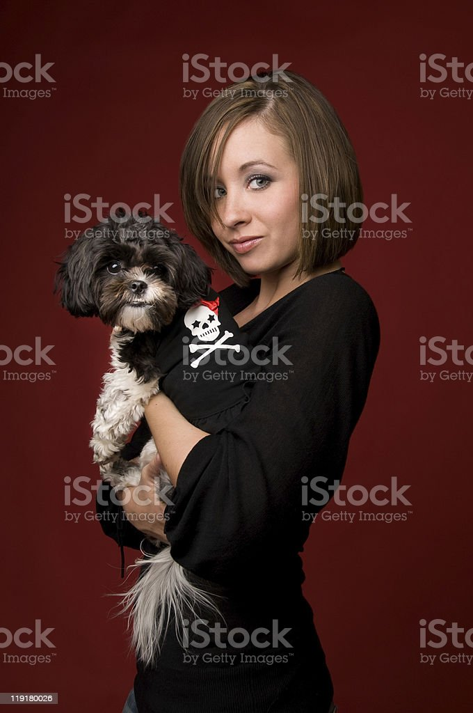 Young Woman Holding Shih Tzu Poodle Dog stock photo