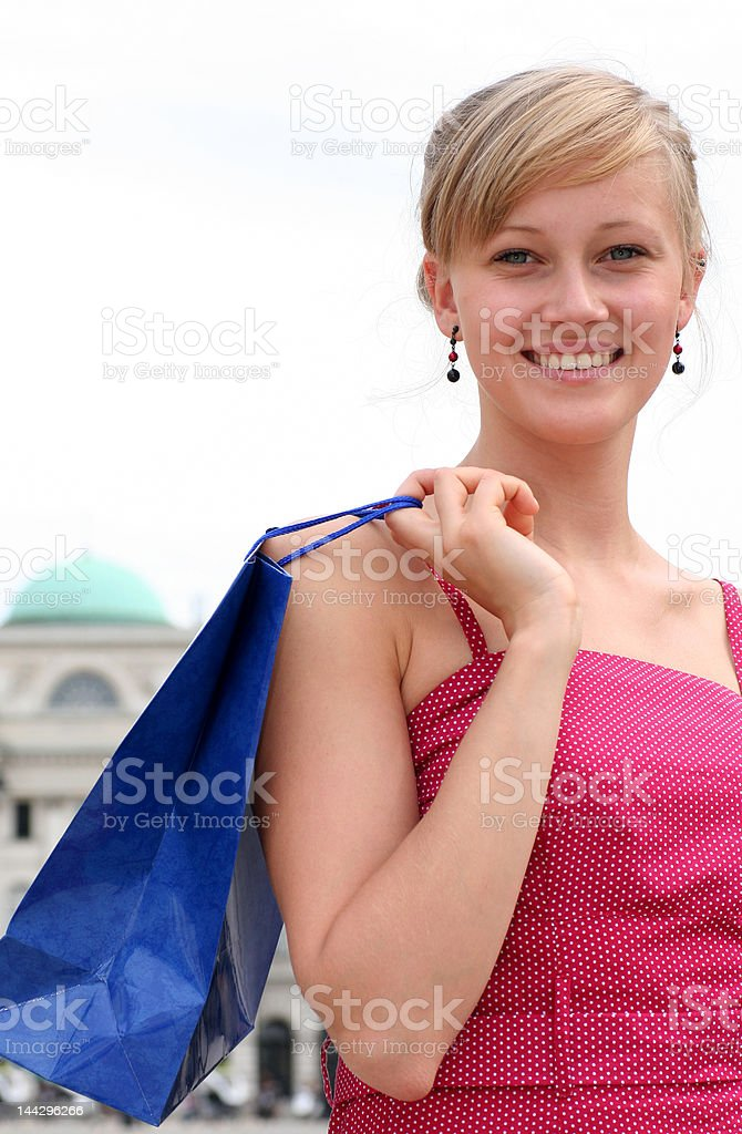 Young woman holding shopping bag royalty-free stock photo