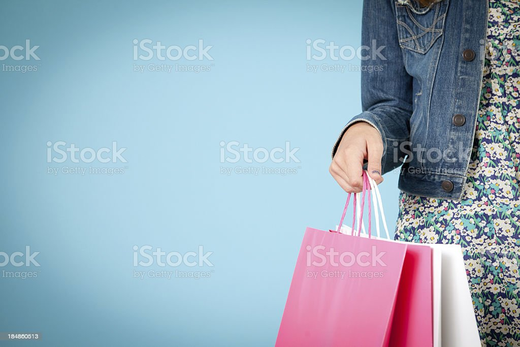 Young Woman Holding Shopping Bags, With Room for Text stock photo