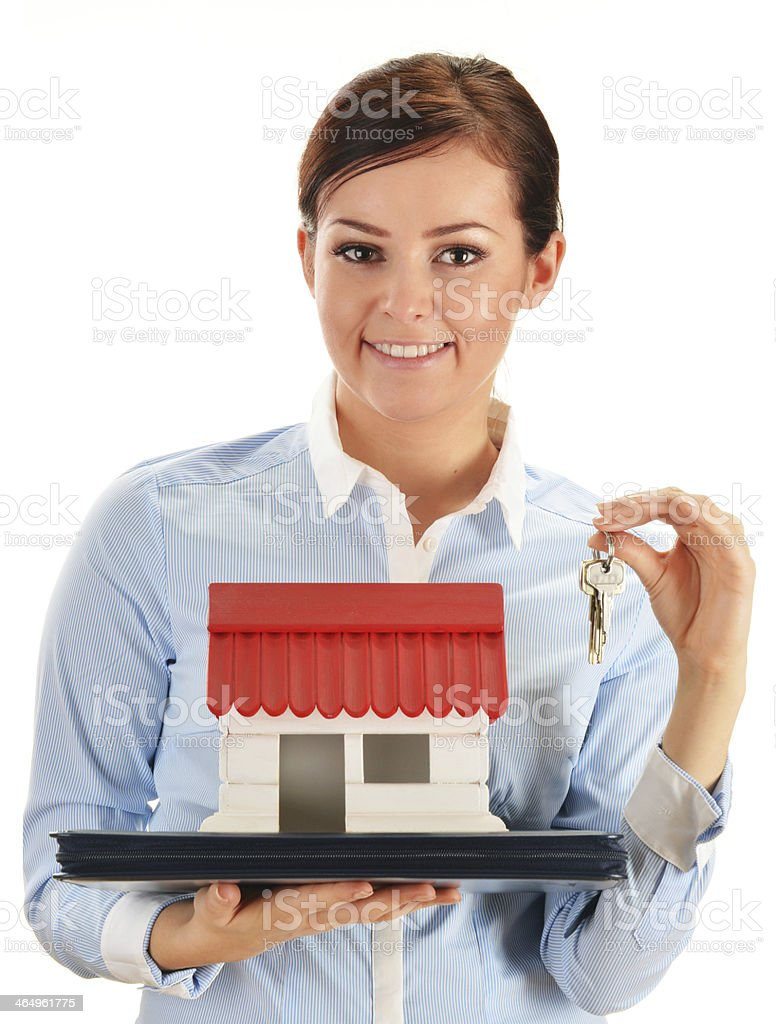 Young woman holding small house isolated on white royalty-free stock photo