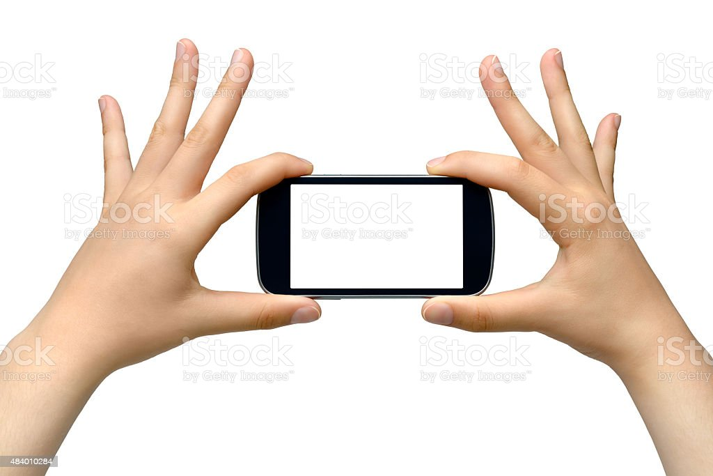 Young woman holding smartphone - isolated on white background stock photo