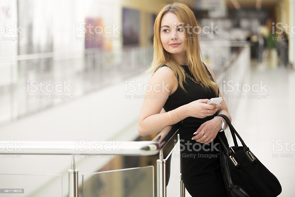Young woman holding smartphone stock photo