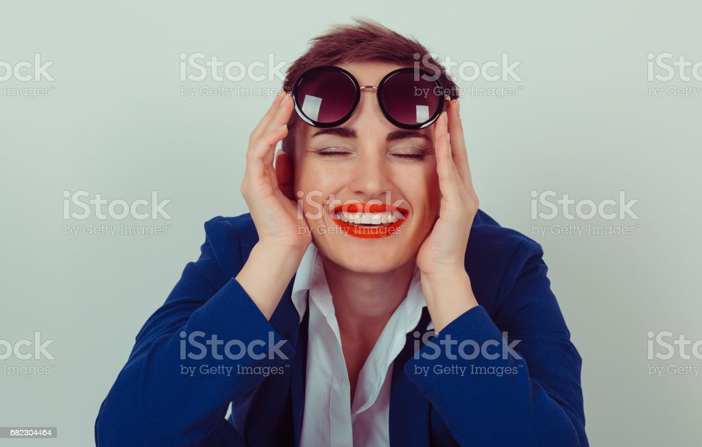 Young woman holding sunglasses smiling stock photo