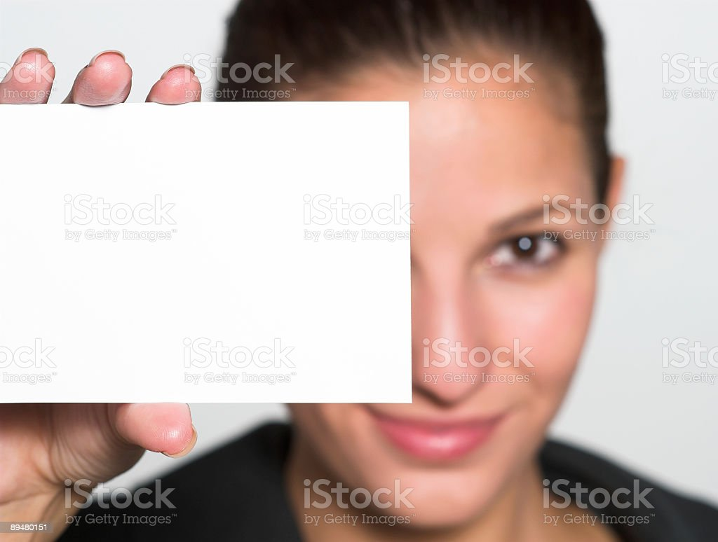 Young woman holding up white paper card stock photo