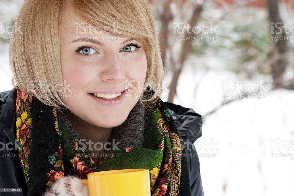young woman holding yellow cup royalty-free stock photo