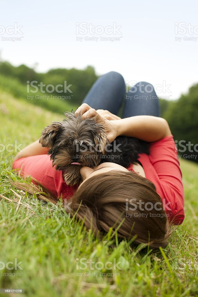 Young woman holding Yorkshire terrier royalty-free stock photo