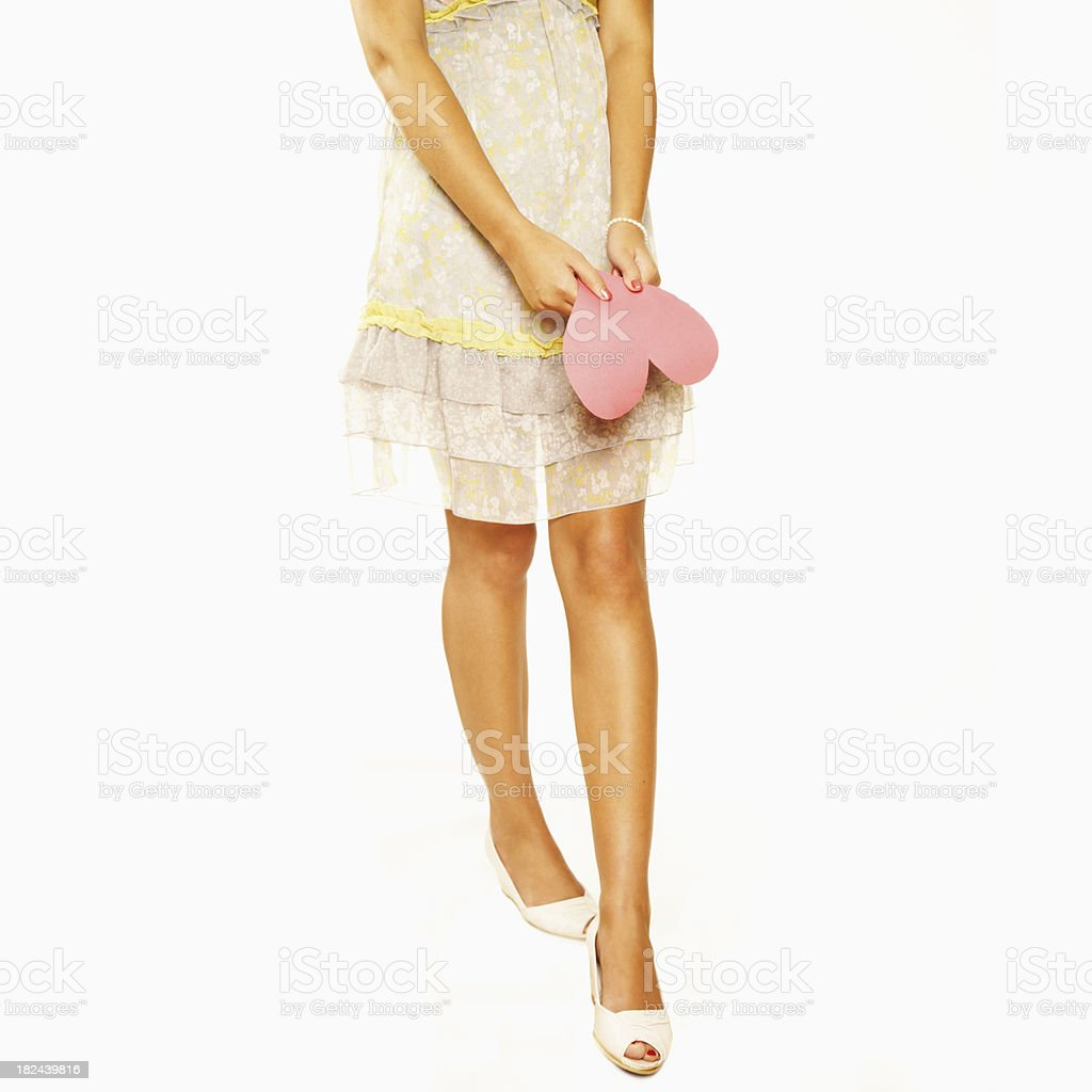 Young Woman Holds a Paper Heart. Isolated. royalty-free stock photo