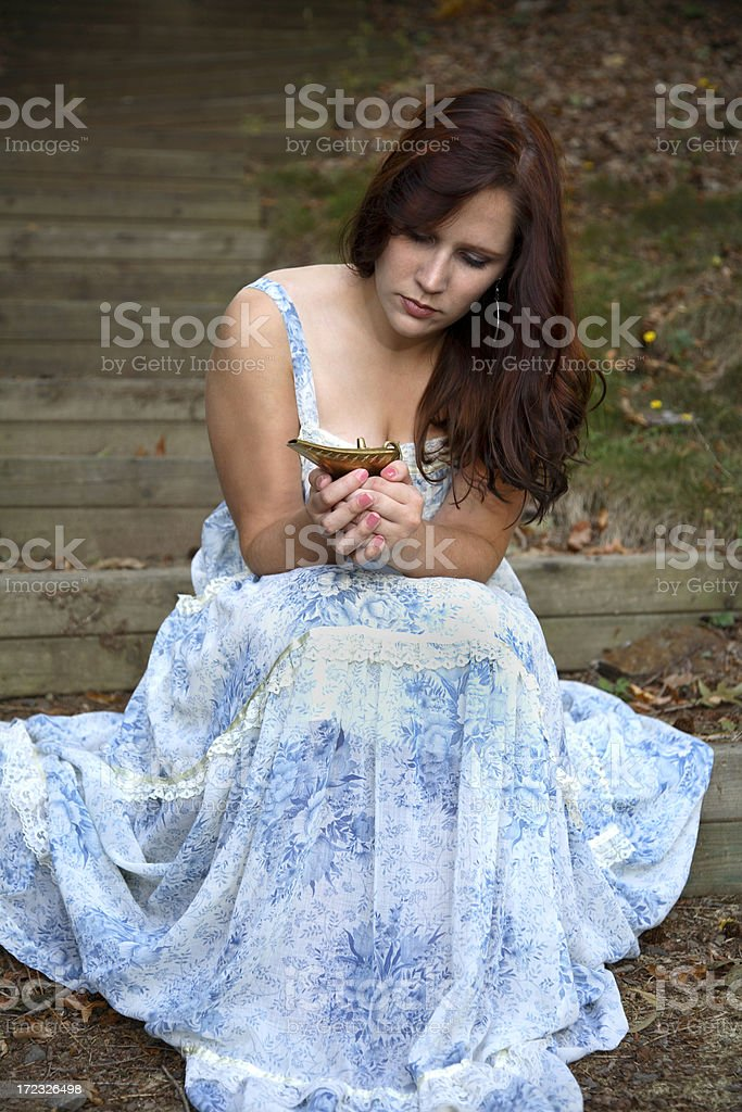 Young Woman Holds  Lamp stock photo