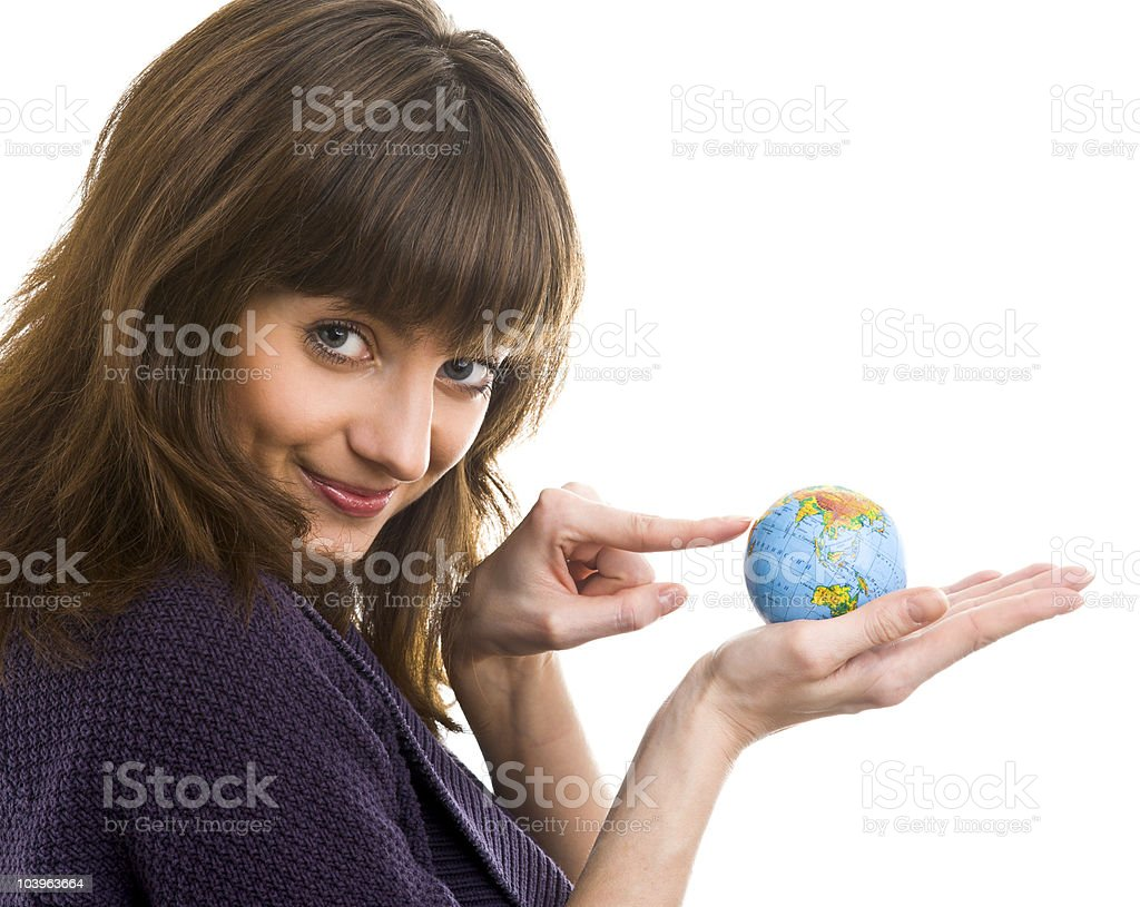 Young woman holds the globe in hands stock photo
