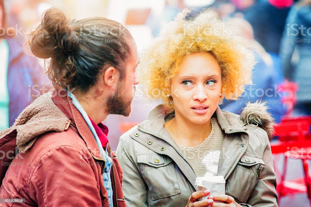 Young woman horrified by her friend's suggestion stock photo
