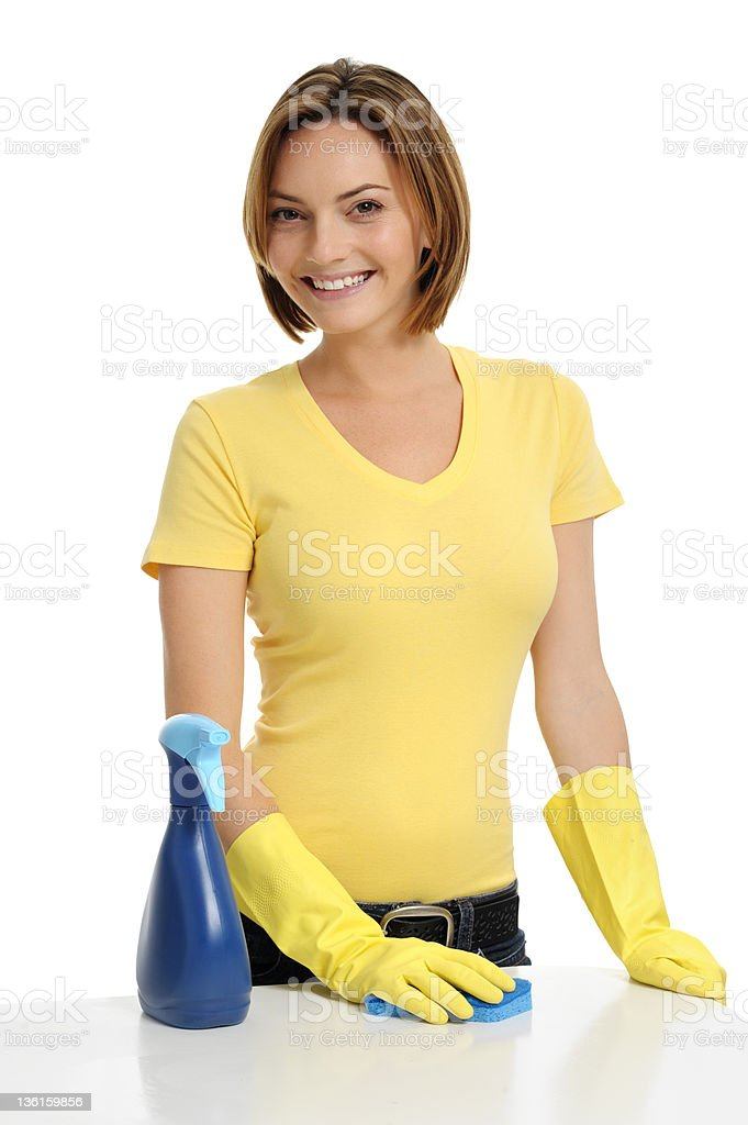 Young Woman Housewife Maid Cleaning Counter Isolated on White Background royalty-free stock photo