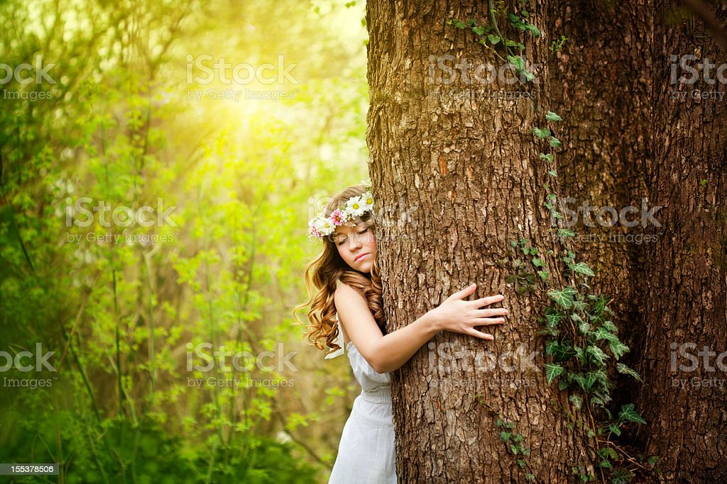 Young woman hugging a tree stock photo