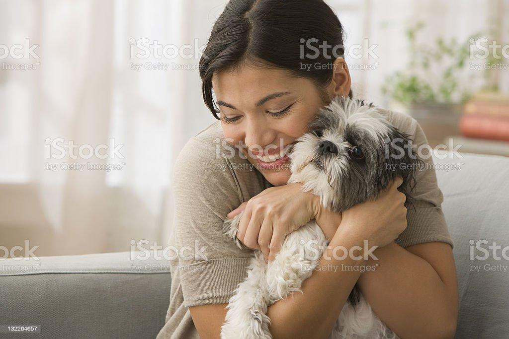 Young Woman hugging dog stock photo