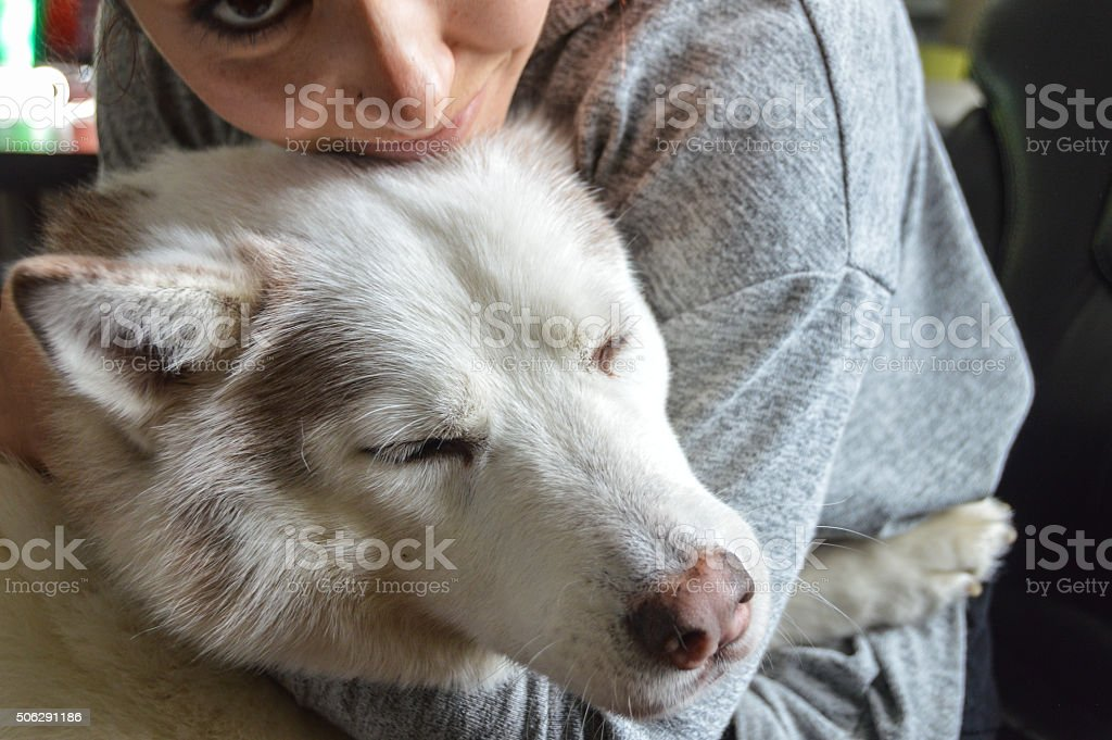 Young woman hugging her dog stock photo