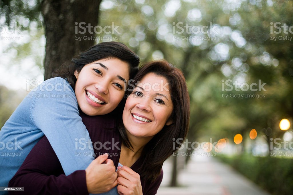 Young woman hugging her mother stock photo