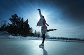 Young Woman Ice Skater Skating on Outdoor Winter Ice Rink