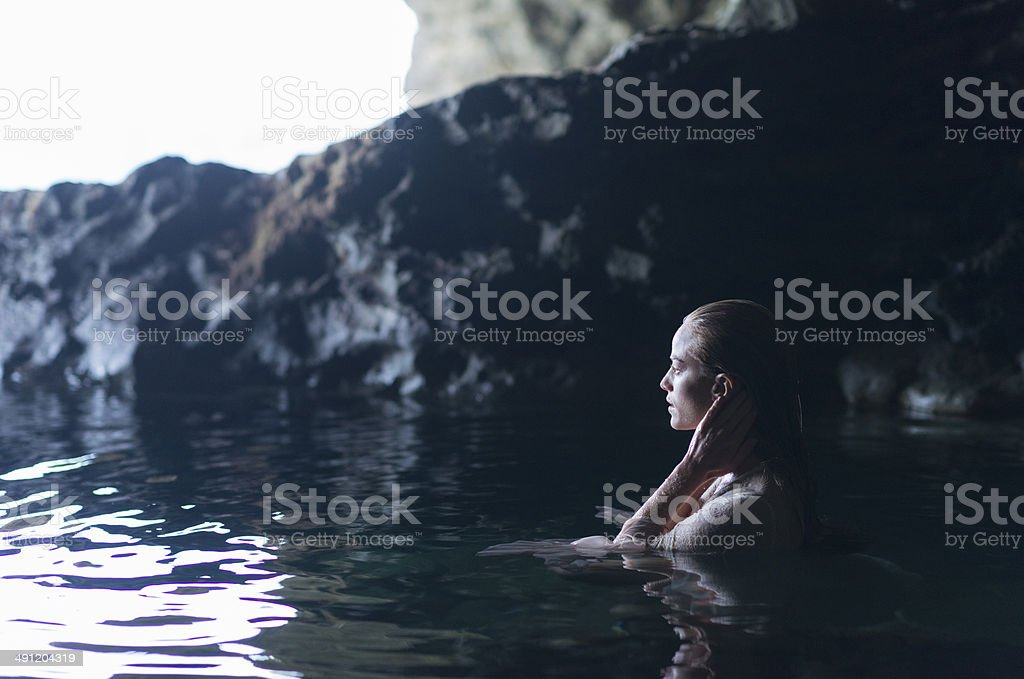 Young Woman In A Cave royalty-free stock photo