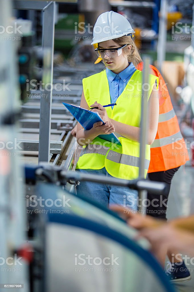 Young woman in a factory stock photo