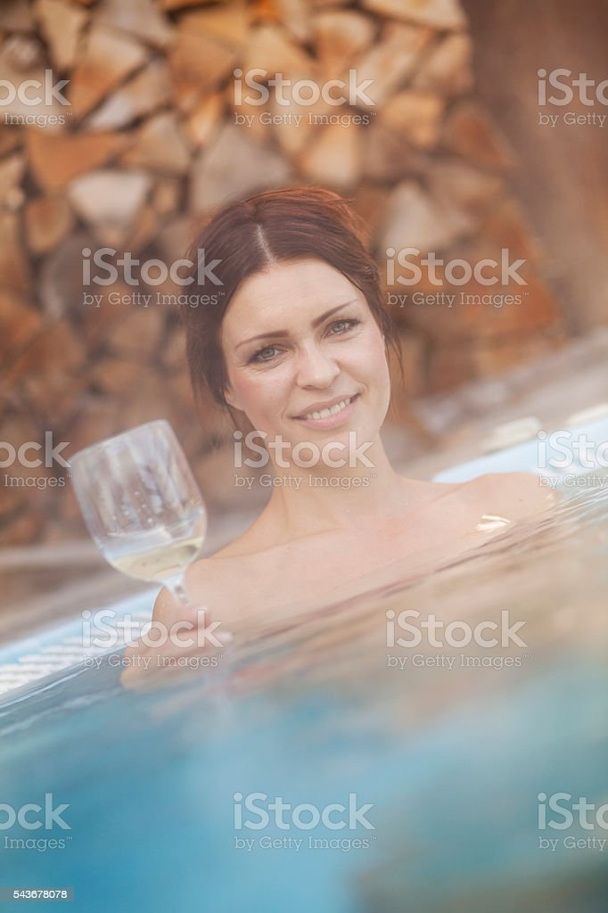 Young woman in a hot tub stock photo