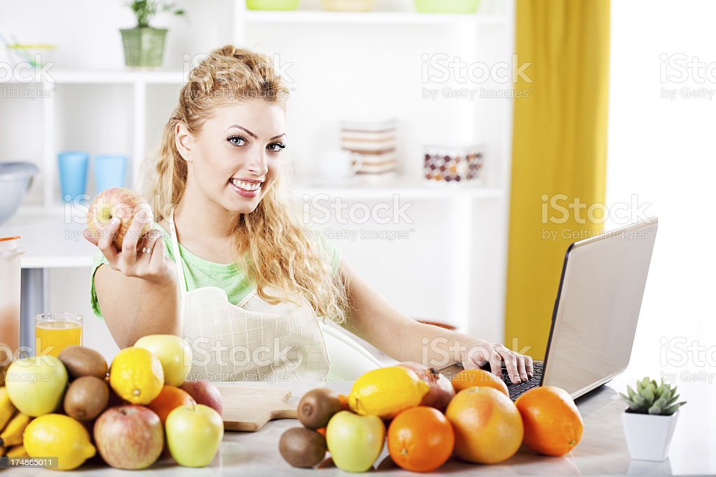Young woman in a kitchen royalty-free stock photo