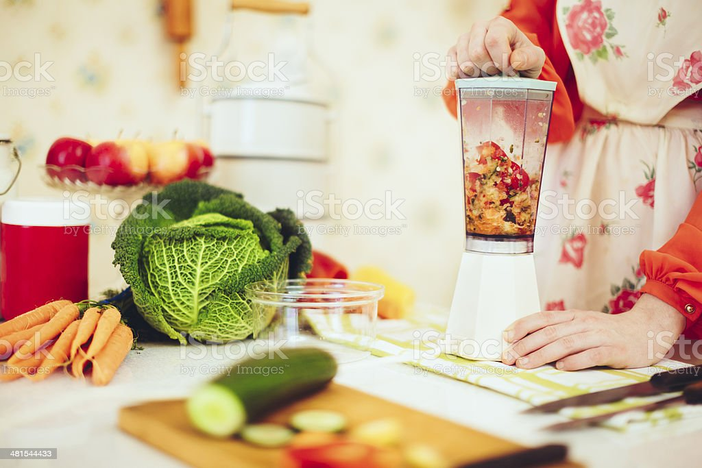 Young woman in a kitchen stock photo