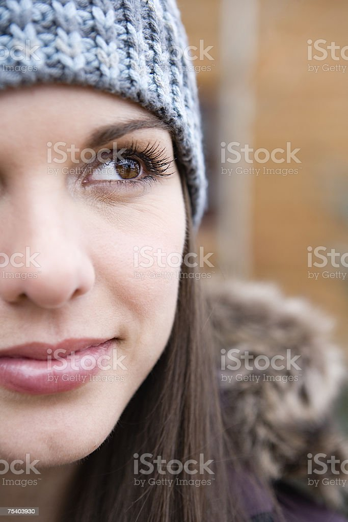 Young woman in a knit hat stock photo