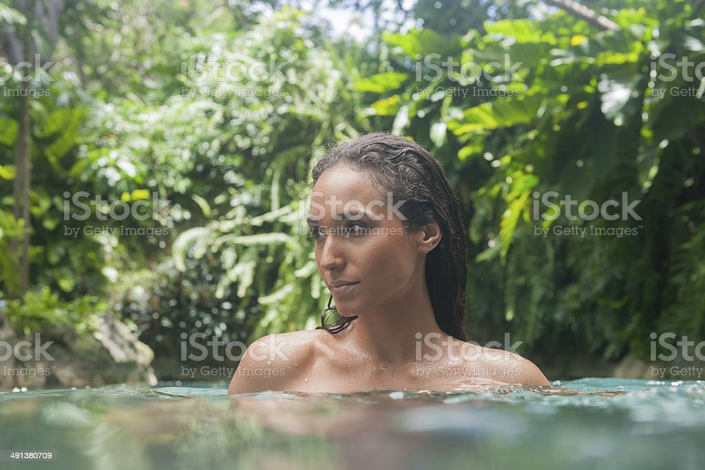 Young Woman In A Lagoon royalty-free stock photo