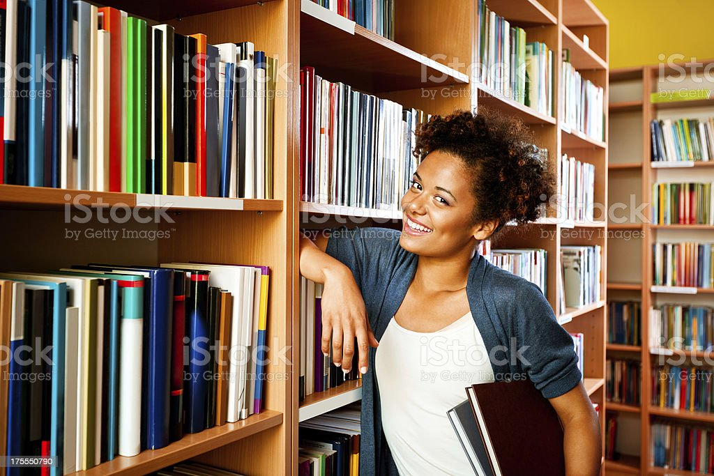 Young woman in a library royalty-free stock photo
