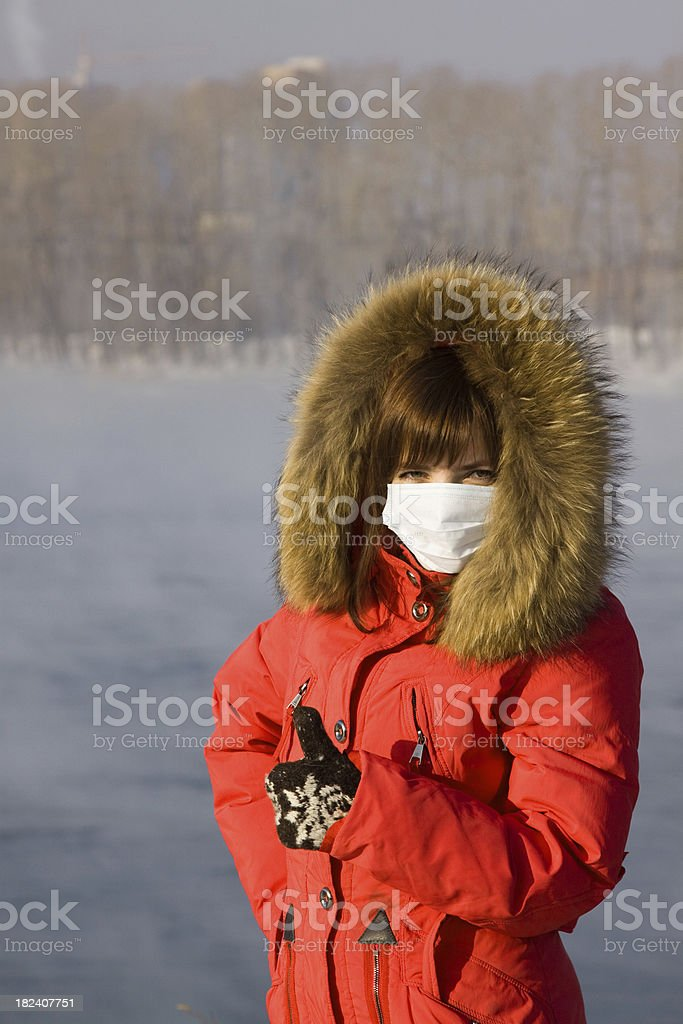 Young woman in a mask against influenza stock photo