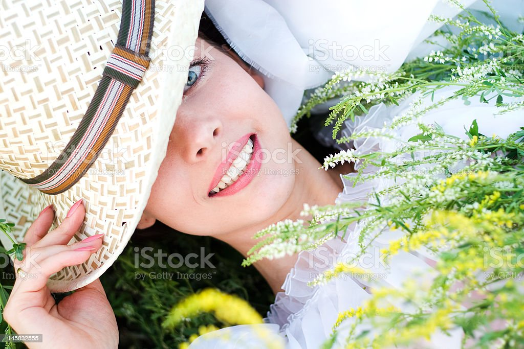 Young woman in a meadow royalty-free stock photo