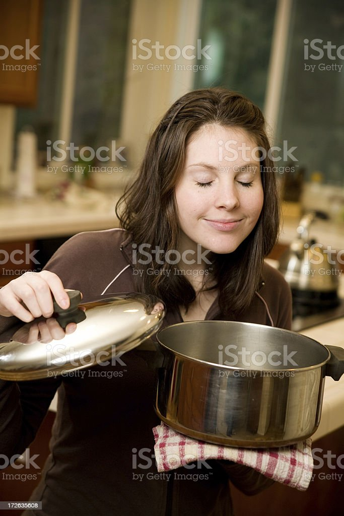 young woman in a modern kitchen royalty-free stock photo