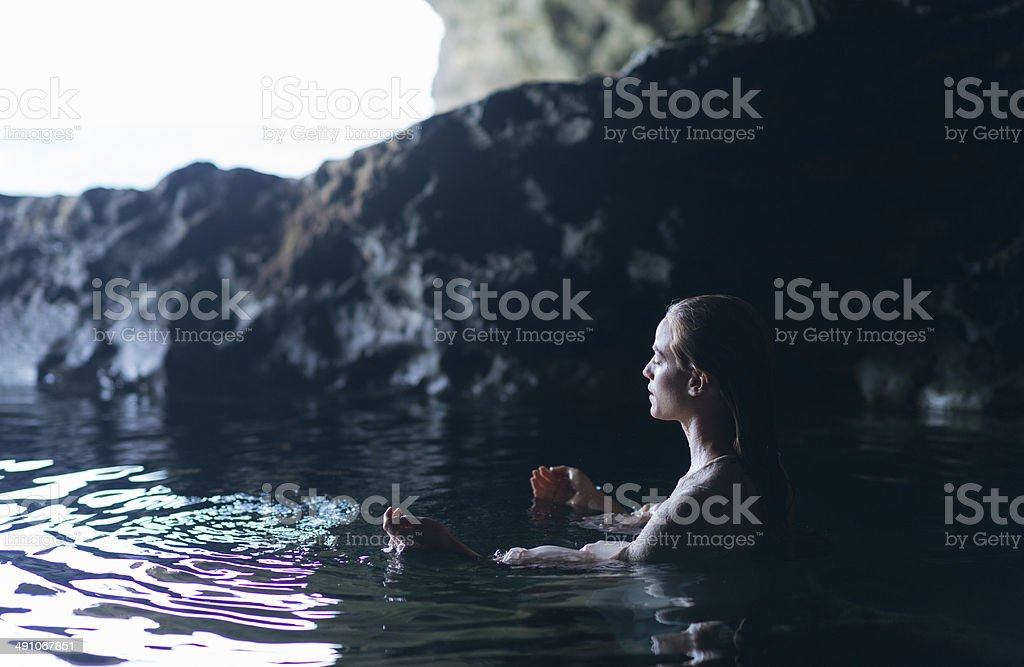 Young Woman In A Natural Pool stock photo