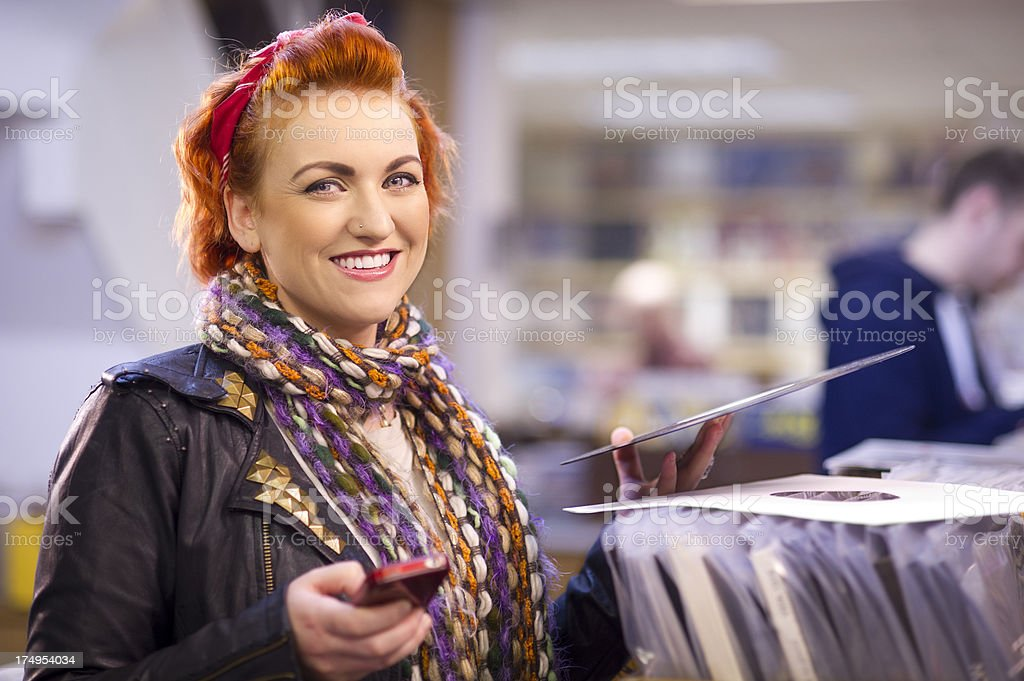 young woman in a record shop royalty-free stock photo