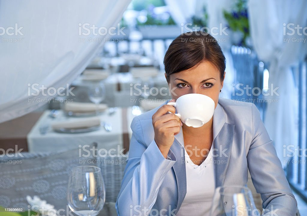 Young woman in a restaurant drinking tea royalty-free stock photo