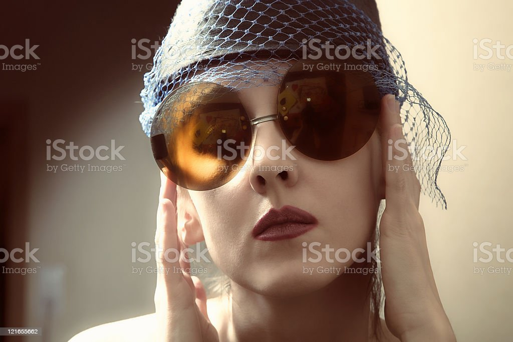 young woman in a retro sunglasses stock photo