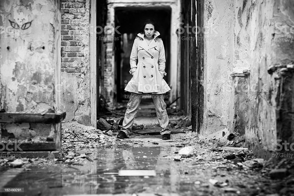 Young woman in a ruined building royalty-free stock photo