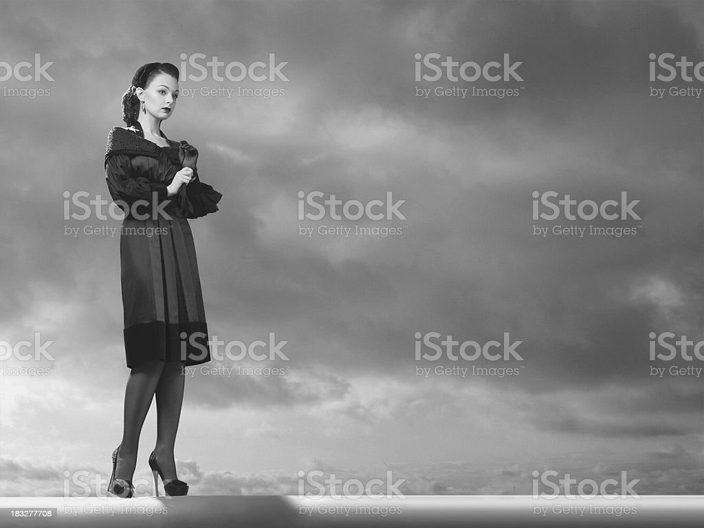 Young woman in a stylish vintage clothings. stock photo
