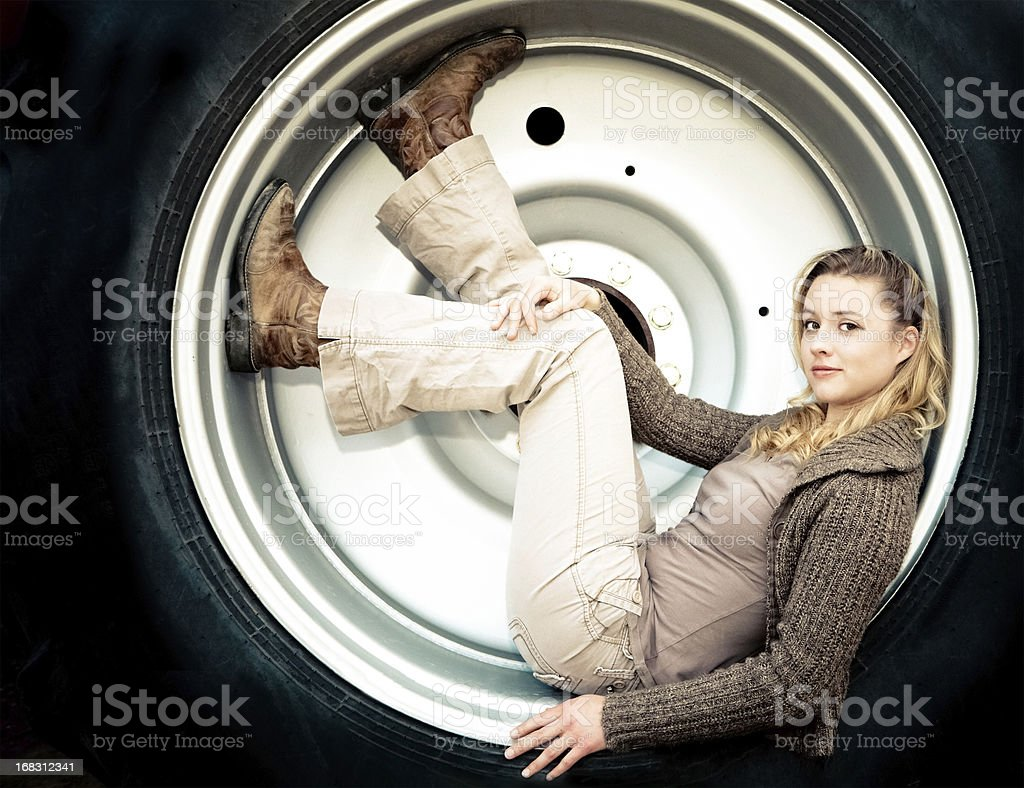 Young Woman In A Tire Rim stock photo