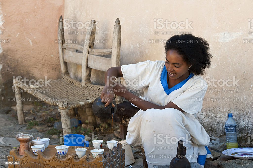 Young woman in a traditional coffee ceremony, Ethiopia royalty-free stock photo