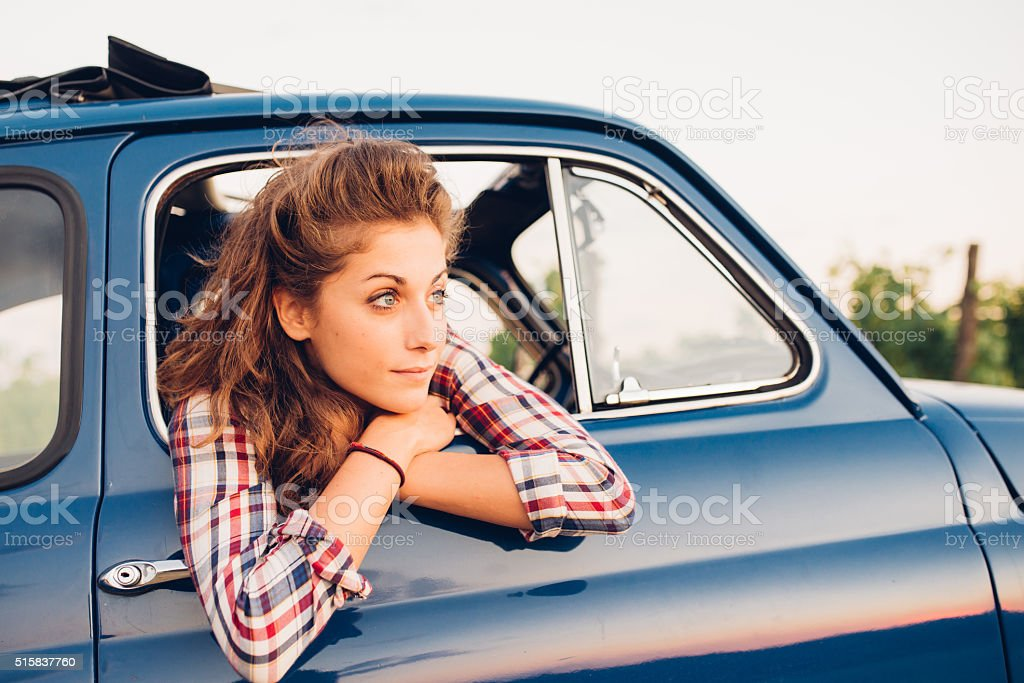 Young Woman In A Vintage Car stock photo