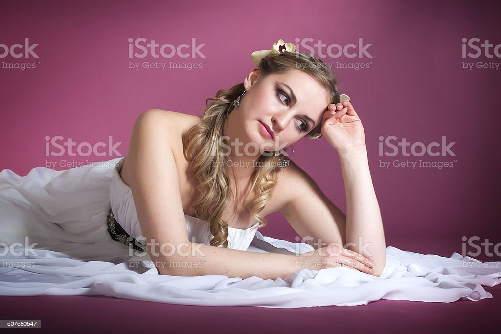 young woman in a wedding dress stock photo