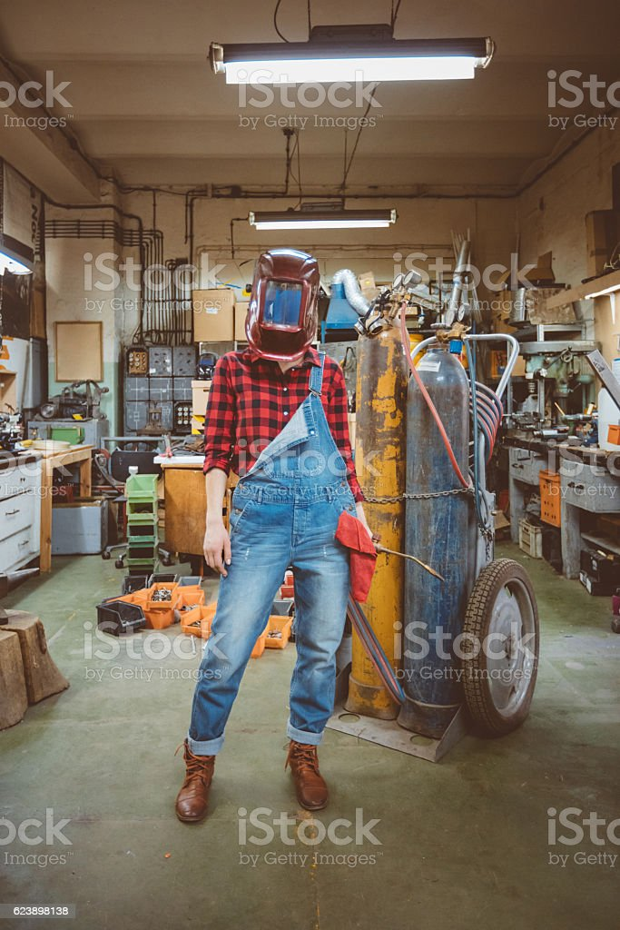 Young woman in a weld workshop stock photo