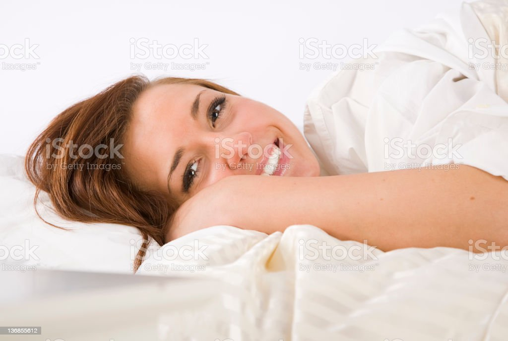 Young Woman in a White Bedroom royalty-free stock photo