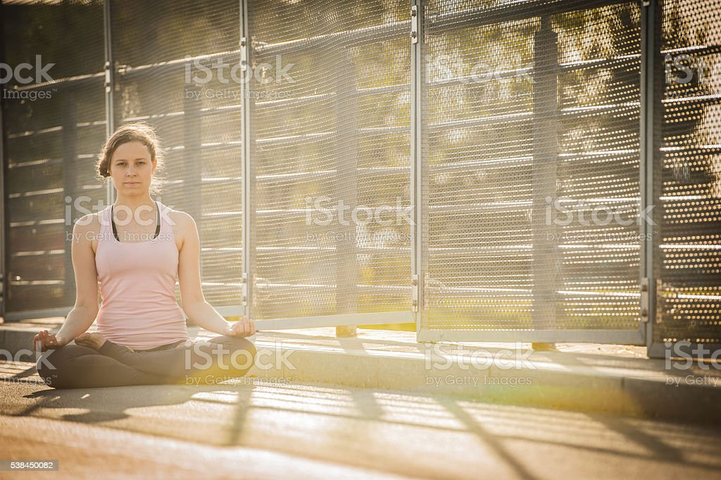 Young woman in a yoga posture stock photo