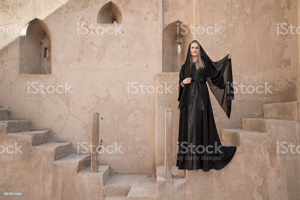 Young Woman in an abaya in Jabrin castle stock photo