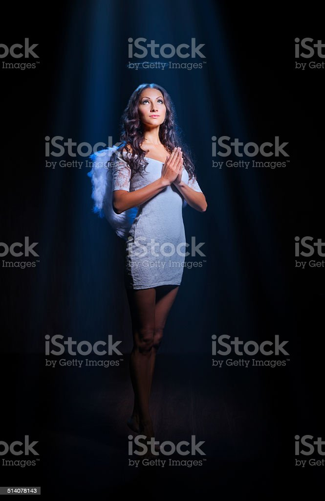 Young woman in an image of angel stock photo