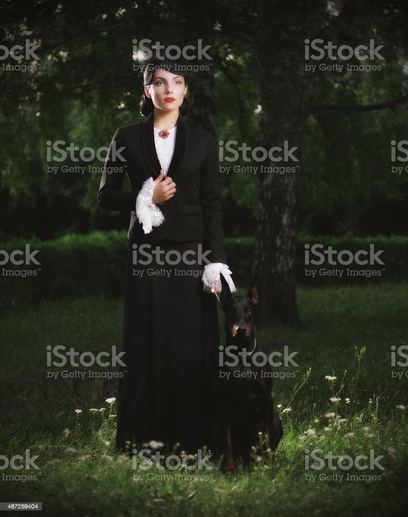 Young woman in ancient costume with dog (ancient ver) stock photo