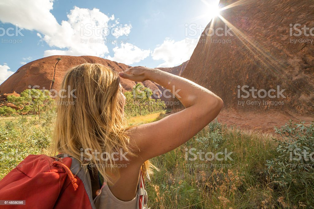Young woman in Australia hiking looks at the spectacular landscape stock photo