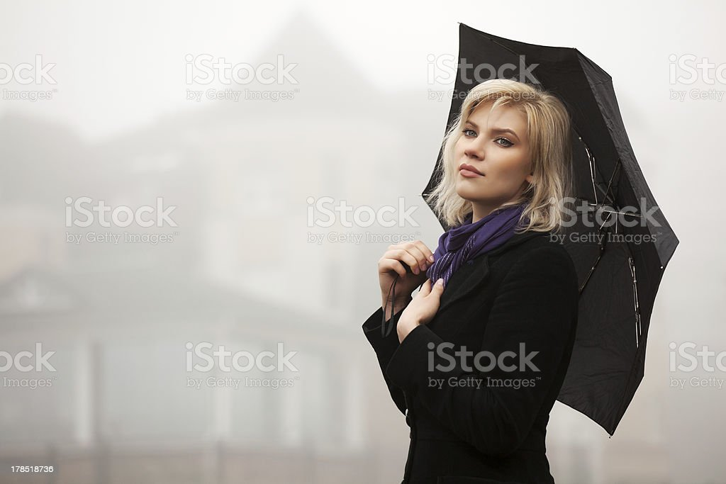 Young woman in autumn foggy morning royalty-free stock photo