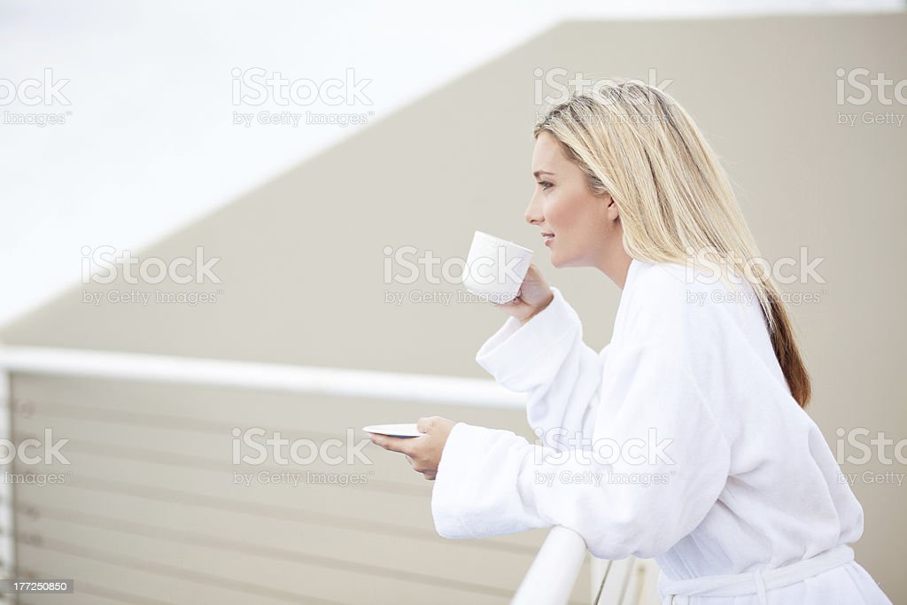 young woman in bathrobe drinking coffee royalty-free stock photo